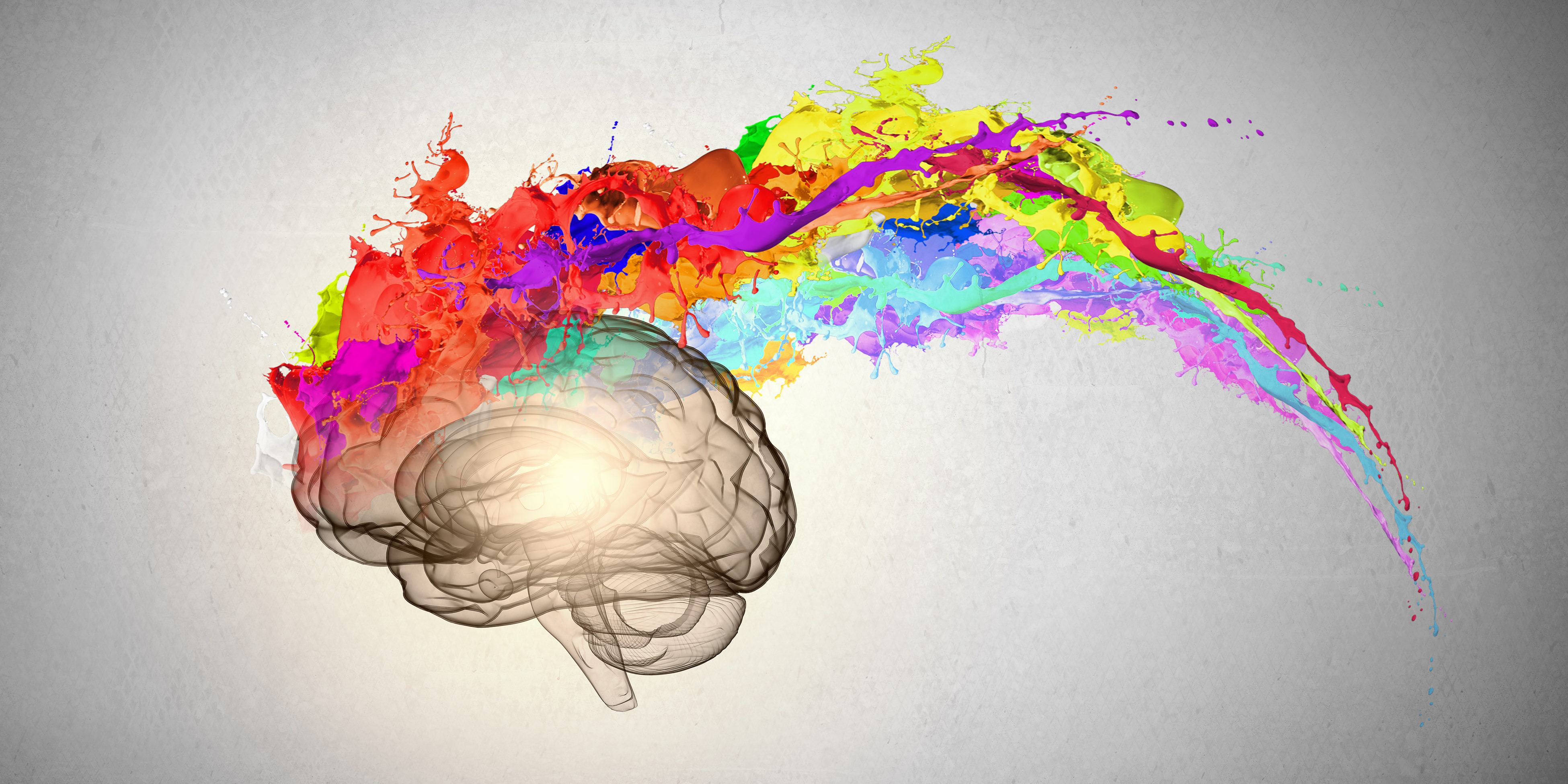 a brain showing creativity - paint coming out of the brain